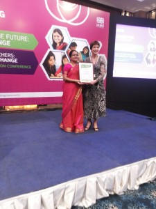 Mrs Gowrilakshmi Receiving the Award for her Action Research